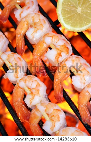 Shrimp kebabs on the grill - stock photo