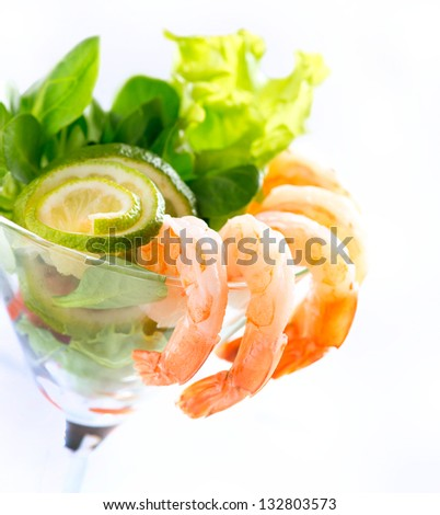 Shrimp or Prawn Cocktail. Isolated on a White Background. Healthy Shrimp Salad with mixed greens and tomatoes. Diet. Shrimps - stock photo