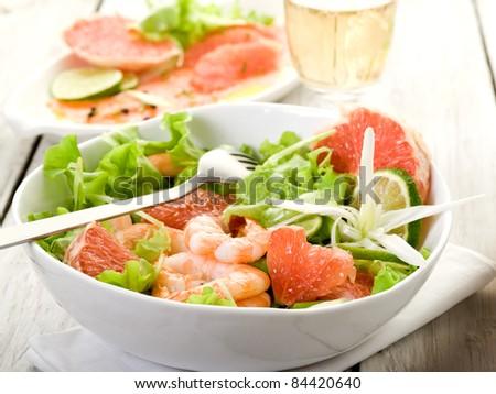 shrimp salad with slice grapefruit and lettuce - stock photo