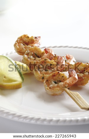 Shrimp skewers served on plate - stock photo