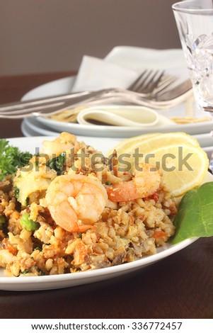 Shrimp stir fry with brown rice - stock photo