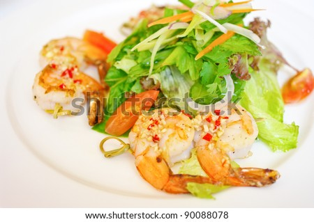 Shrimp with salad in white dish - stock photo