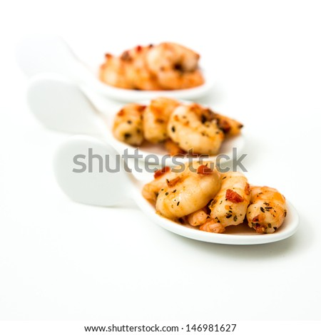Shrimp with white wine sauce on table  - stock photo