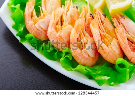 Shrimps and salad on a plate - stock photo