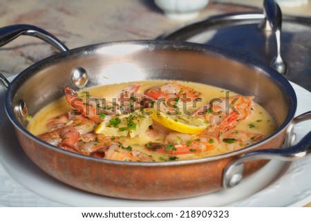 Shrimps in garlic butter sauce dish - stock photo