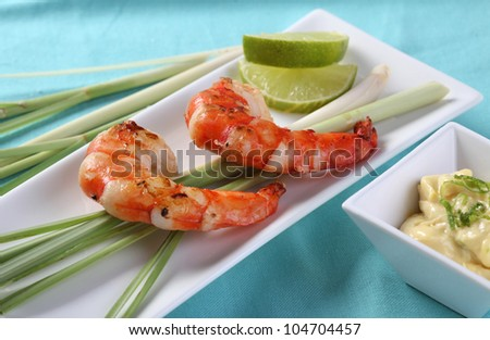 Shrimps on lemongrass with aioli dipping and sliced lime - stock photo