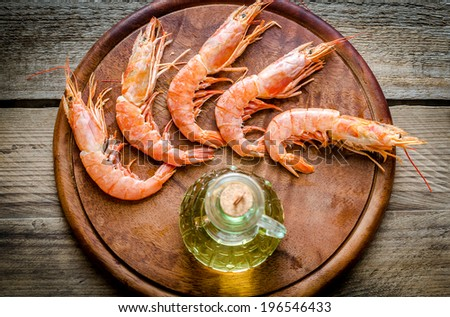 Shrimps on the wooden board - stock photo