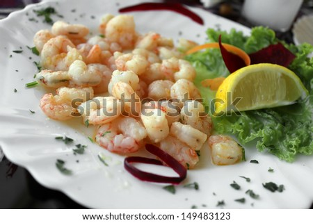 Shrimps With Green Salad And Lemon - stock photo