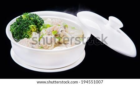 Shrimps Wonton Soup, Chinese traditional cuisine  isolated on black background - stock photo