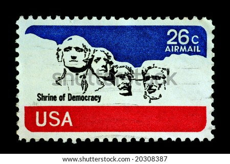 Shrine of democracy on USA stamp featuring mount rushmore national memorial . Stone Sculptures of George Washington, Thomas Jefferson, Theodore Roosevelt, and Abraham Lincoln. - stock photo