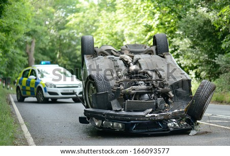 SHROPSHIRE, UK - June, 18 2013:  vehicle flipped onto roof, police attended incident and found the youth driving was under the influence of drugs  on 18 June, 2013.  - stock photo