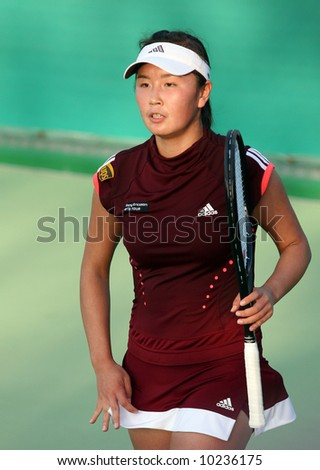 Shuai Peng of China at the Qatar Total Open, February 19, 2008. She lost her first-round match against France's Nathalie Dechy. - stock photo