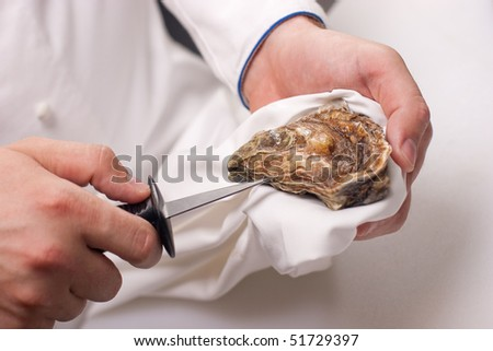 shucking of oyster - stock photo