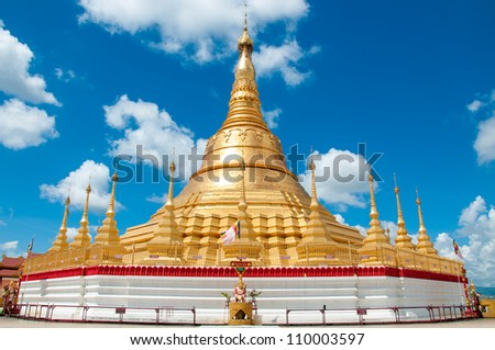 Shwedagon Pagoda is a beautiful golden pagoda located at Tachileik, Myanmar. - stock photo