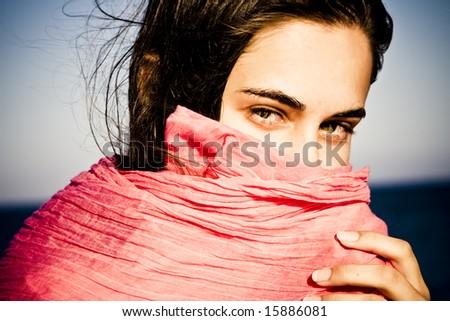 Shy beautiful green eyed woman behind veil. - stock photo