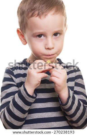 Shy boy with candy on isolated white - stock photo