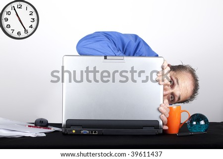 shy businessmen hiding behind his laptop - stock photo