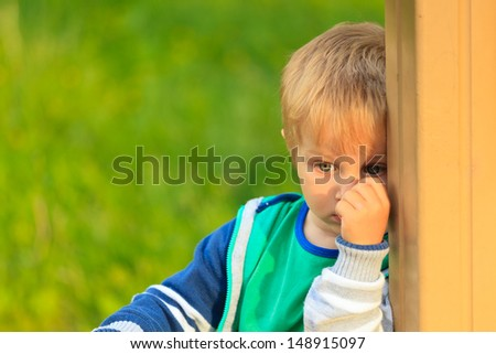 shy little boy portrait - stock photo