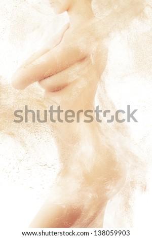 shy naked woman body in sand powder - stock photo