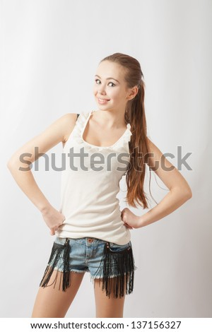 Shy Teen girl portrait, over white background. Glamorous young sexy woman on white background looking very sexy - stock photo