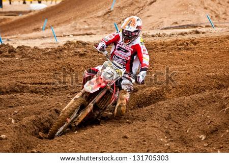 SI RACHA, THAILAND - MAR. 10 : Hurri Kullas (151) rider of Honda Gariboldi during MX2 race of The FIM Motocross World Championship Grandprix of Thailand, on March 10, 2013. Thailand. - stock photo
