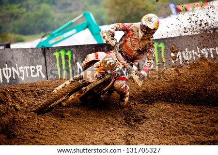 SI RACHA, THAILAND - MAR. 10 : Jakes Nico (45) rider of Monster Energy Yamaha during MX2 race of The FIM Motocross World Championship Grandprix of Thailand, on March 10, 2013. Thailand. - stock photo