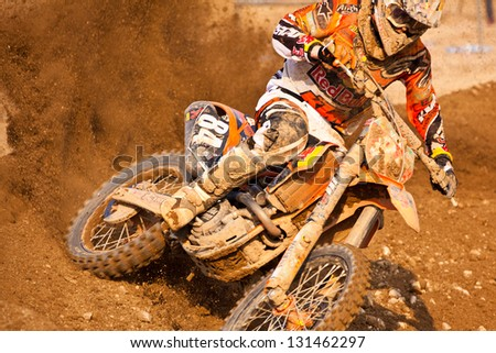 SI RACHA, THAILAND - MAR. 10 : Jefferey Herlings rider no. 84, Red Bull KTM Factory Racing won in MX2 during The FIM Motocross World Championship Grandprix of Thailand, on March 10, 2013. Thailand. - stock photo