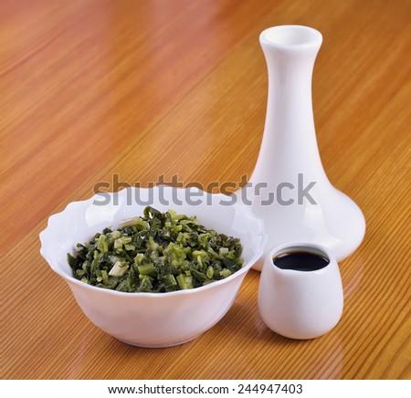 Siberian tasty snack - pickled ramsons (Allium ursinum) - stock photo