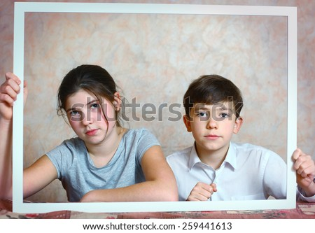 siblings brother and sister cute portrait in frame - stock photo