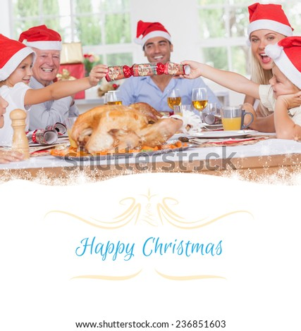 Siblings pulling a christmas cracker against border - stock photo
