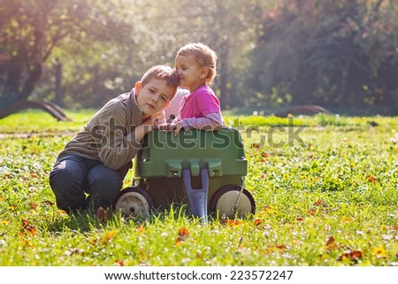 Siblings showing off their love - stock photo