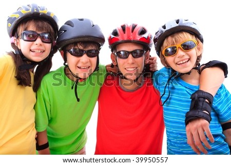 Siblings with helmets - stock photo