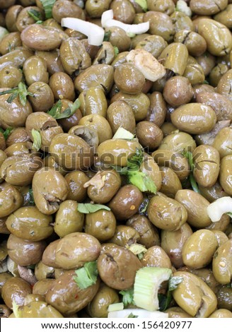 Sicilian green olives in spicy vegetable market sales - stock photo