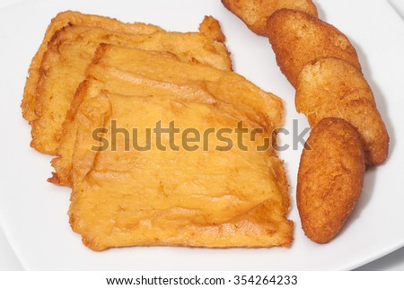 sicilian panelle and croquettes on dish. typical Sicilian food. Selective focus with shallow depth of field - stock photo