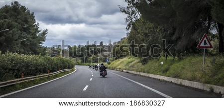SICILY, ITALY - APRIL 6, 2014: H.O.G. Malta Chapter riding their Harley-Davidson motorcycles in Sicily. Harley Owners Group (H.O.G.) is made up of various local chapters from around the world. - stock photo