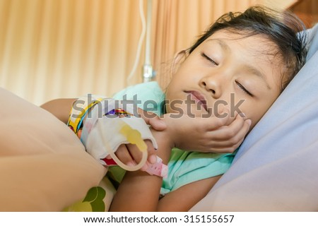 Sick Asian Ethnic Little Girl Inpatient Sleeping in Hospital Room - stock photo