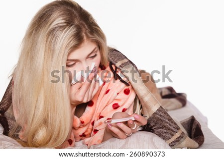 sick beautiful girl sleeping in the bed next to medicines, napkins and tablets. concept. girl sick in bed - stock photo