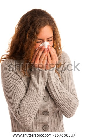 sick brunette girl got a cold isolated on white background blowing in handkerchief - stock photo