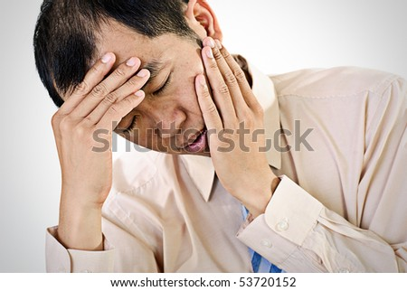 Sick businessman portrait of Asian with painful expression. - stock photo