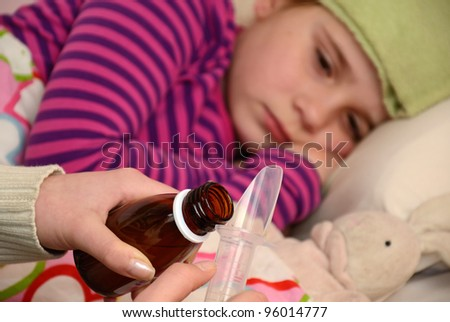 Sick child girl waiting for her medication - stock photo
