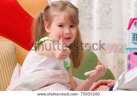 Sick child in bed recovers at home on bed - stock photo