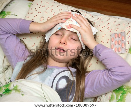 Sick girl lying in bed  - stock photo