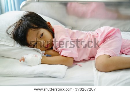 sick girl lying in bed,asian little girl 3 year old - stock photo
