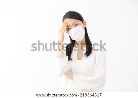 Sick japanese woman - stock photo