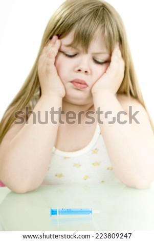sick little girl is afraid of injections/sick little girl - stock photo
