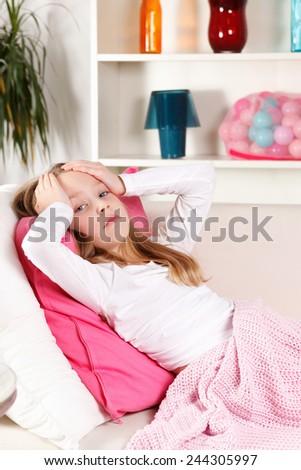 Sick little girl with headache - stock photo