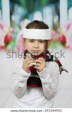 Sick little girl with headband and thermometer in hands - stock photo