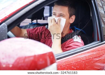 sick man driving car   - stock photo