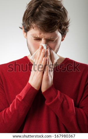 Sick man isolated has runny nose - stock photo