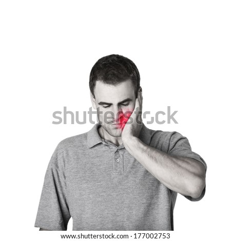 sick man touching his cheek with a hand - stock photo